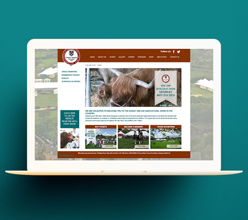 Otley Show new homepage displayed on laptop