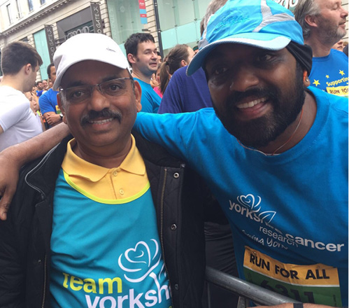 Bobby Patel with father Mohan after completing Leeds 10k in July 2016