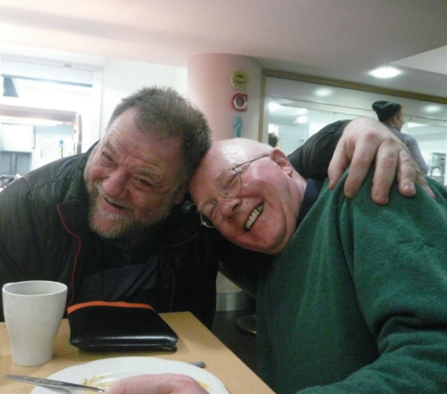 Two smiling residents of St George's Crypt homeless charity in Leeds